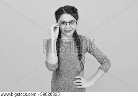Fashion Eyewear And Trendy Eyeglasses. Happy Fashionista Yellow Background. Little Child With Long H