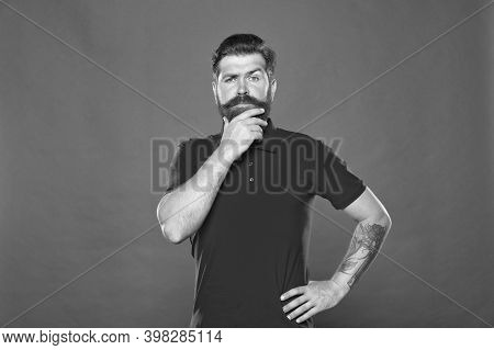 Why So Serious. Serious Look Of Brutal Hipster. Bearded Man Think Red Background. Serious And Though