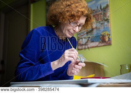 Age, Retirement, Creativity, Imagination And Art. Creative Work. Caucasian Mature Female Paints Pict