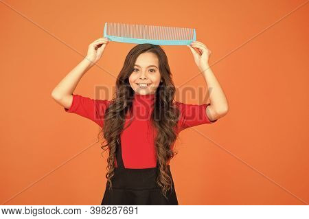Cheerful Smiling Little Kid With Giant Comb. Hairdresser Salon. Combing Hair. Styling Tips. Hairbrus