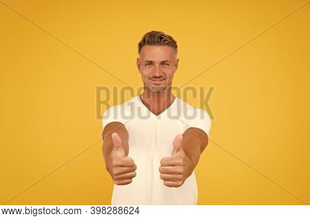 Approved. Happy Man Give Thumbs Ups Yellow Background. Promoting And Approving. Promoting Product. S