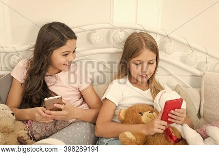 Girlish Leisure Happy Childhood. Girls With Smartphone Use Modern Technology. Lets Take Selfie. Send