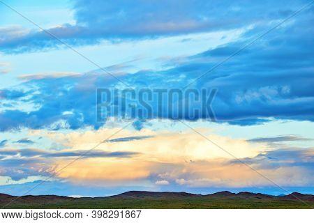 Evening cloudy sky over the sand dunes. Western Mongolia, Mongol-Els desert.