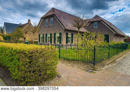 Wonderful Luxury Dutch House With Thatched Roof And Orderly Front Yard. Spectacular Garden With Gree