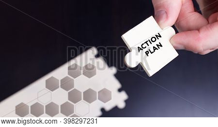 Business, Technology, Internet And Network Concept. Young Businessman Shows The Word: Action Plan