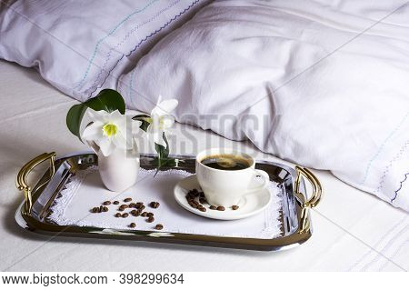 Morning Coffee In Bed On Elegant Silver Tray. Cup Of Coffee On Exquisite Embroidered Napkin As Best