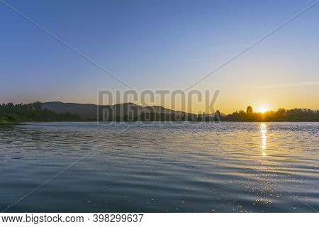 Summer River Landscape With Blue Sky And Sunrise.
