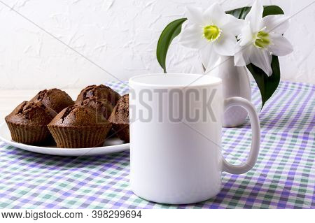 White Mug Mockup With Chocolate Muffins On Plate And White Flowers.  Empty Mug Mock Up For Design Pr