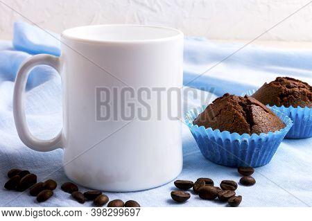 White Mug Mockup With Chocolate Muffins.  Empty Mug Mock Up For Design Presentation.