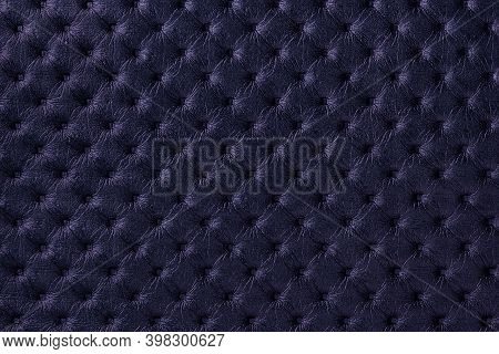 Texture Of Navy Blue Leather Background With Capitone Pattern, Macro. Dark Purple Textile Of Retro C