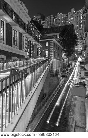Traffic In Old Street Of Central District Of Hong Kong City At Night