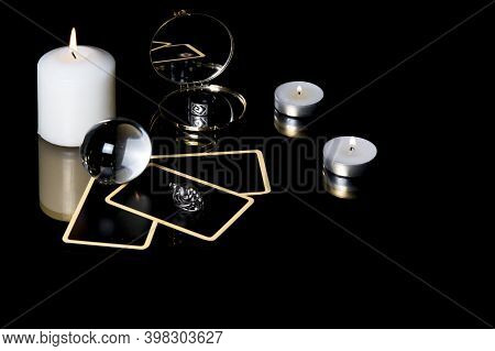 Christmas Magical Sessions With Tarot Cards, Candle, Ring And Mirror Isolated On Black Background. M