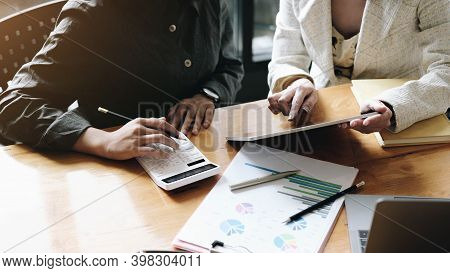 Group Of Businesswoman And Accountant Checking Data Document On Digital Tablet For Investigation Of