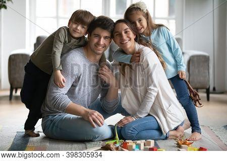 Happy Small Preschool Kids Siblings Cuddling Loving Parents.