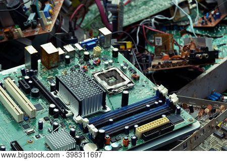 Old Computer Chip, Garbage Disposal In A Junkyard.