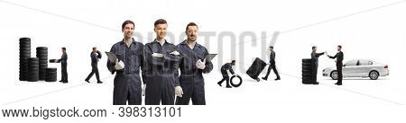 Auto mechanics and workers carrying car tires isolated on white background