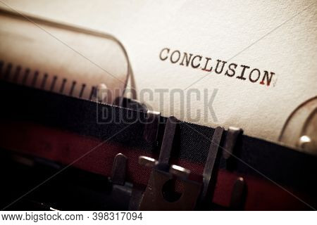 Conclusion word written with a typewriter.