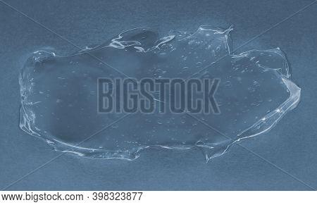 Transparent Gel On Blue Background. Beauty Concept