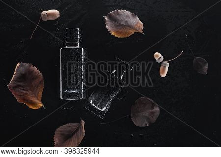 Different Perfumes On A Dark Background. Beauty Concept