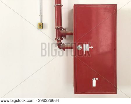 Fire Extinguisher Box And Switch Against Blank Wall