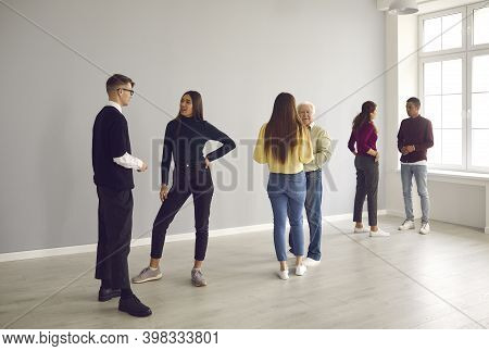 People Standing In Pairs And Getting To Know Each Other In Group Therapy Session
