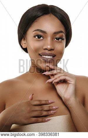 Beauty portrait of african american woman with clean healthy skin. Young model with dark skin and perfect smile. Cosmetics, makeup and fashion. Skin care and beauty concept. Smiling beautiful afro gir