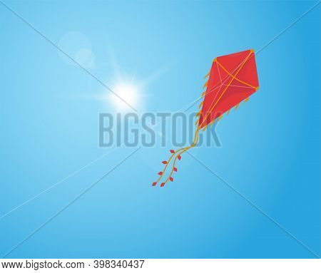 Red Kite Flying In The Blue Sky. Makar Sankranti Or Battle Kite With Red And Golden Colors With Semi