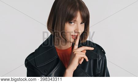 Beautiful Casual Girl With Bob Hair Has Intriguing Look Asking To Keep Secret Isolated On White Back