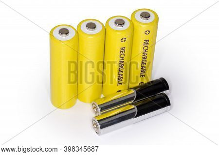 Rechargeable Batteries Aa Size And Non-rechargeable Alkaline Batteries Aaa Size On A White Backgroun