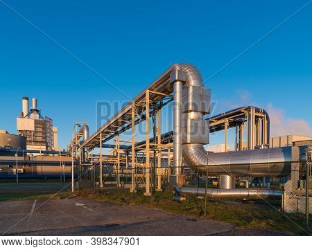 Large Industrial Pipelines At Sunset In The Netherlands