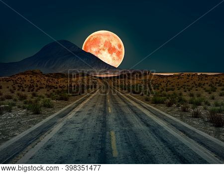 A Desert Road At Night Leading Off Into Infinity With A Huge Full Moon On The Horizon, 3d Render.