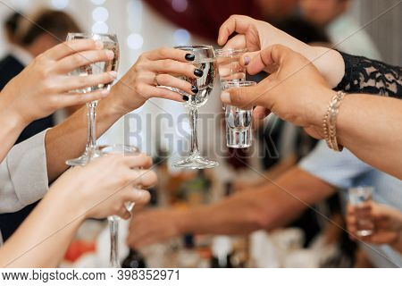 Hands With Glasses. The Clink Of Glasses And Toast.