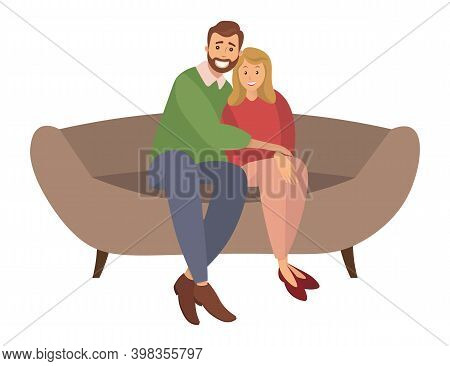 A Man And A Woman Are Sitting On A Large Brown Sofa. The Bearded Guy Is Hugging The Girl In The Red