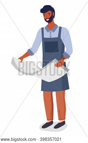 Male Worker In A Printing Studio Isolated On White. Man In Uniform Holds A Stack Of Large Sheets Of