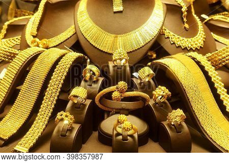 Beautiful Gold Necklaces, Rings And Bracelets On Stands Close Up