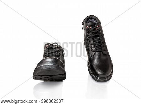 Pair Of Black Winter Boots Made Of Genuine Leather. Men's Clothing. Walking Concept. Isolated Over W