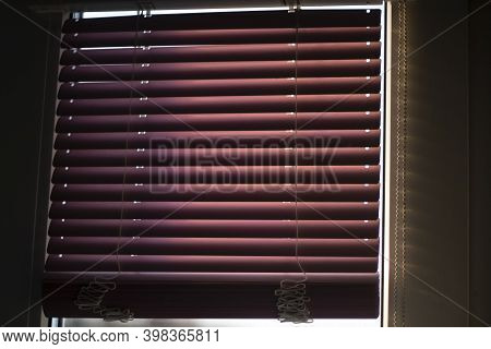 Blinds On The Window. Protecting The Window From Sunlight. Blinds On The Window Frame. Red Blinds.
