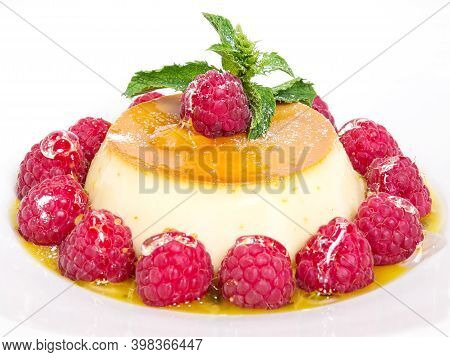 Creme Brulee. Dessert With Caramel Crust And Berries.