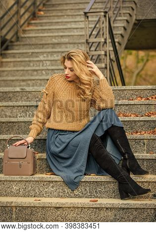 Fall Fashion Trend. Wearable Trends. Layer Oversize Knit Over Girly Skirt. Fall Outfit Formula. Styl