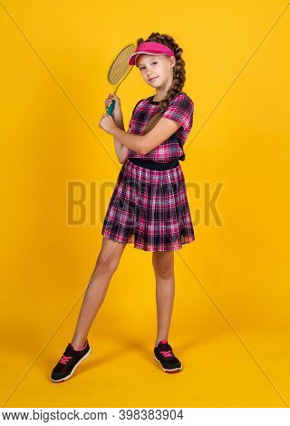 Happy Girl Holding Sport Equipment. Kid Hold Tennis Racket. Child Wear Fitness Cap. Childhood Activi