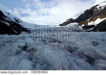 Directly At The Glacier: Columbia Icefield / Athabsca Glacier In The Canadian Rocky Mountains In Ban