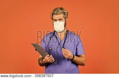 Seek Urgent Medical Attention. Coronavirus Concept. Man Bearded Doctor With Folder. Medical Treatmen