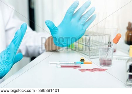 Researchers Spilled Infected Blood Or Chemicals Spilling Over The Table.