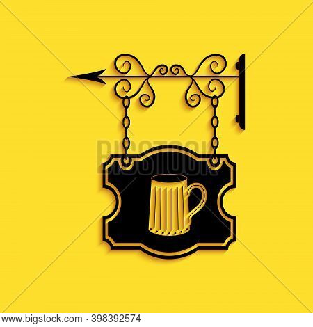 Black Street Signboard On Forged Brackets With Wooden Mug Of Beer Icon Isolated On Yellow Background