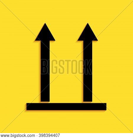 Black This Side Up Icon Isolated On Yellow Background. Two Arrows Indicating Top Side Of Packaging.