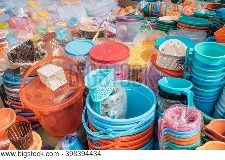 Cheap plastic household items for sale on the market close-up Environment pollution concept