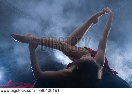 Nude Sexual Woman Doing Yoga. Dark Romantic Light. Health And Sexuality