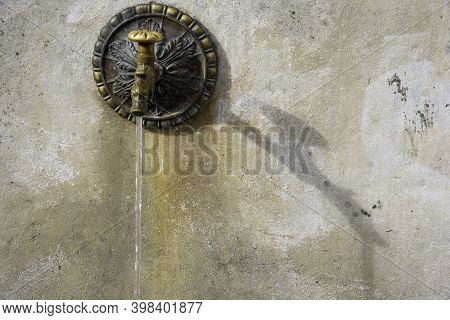 Old Brass Fountain. Vintage Object Used In The Mountains To Water Livestock. Copy Space.
