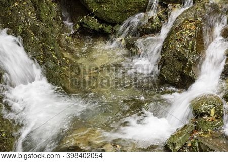 Water Fall In The Middle Of The Woods. Footpath With Autumn Colors.