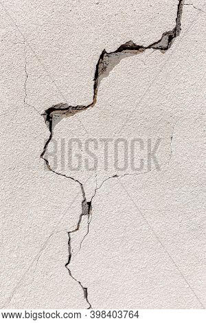 Crack On A Grey Concrete Wall Of Abandoned House In Al Madam Ghost Village In United Arab Emirates,